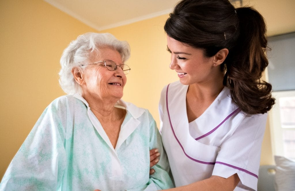 Elderly Woman and Care Nurse