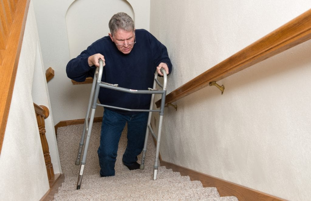 Elderly Man Walking up the Stairs